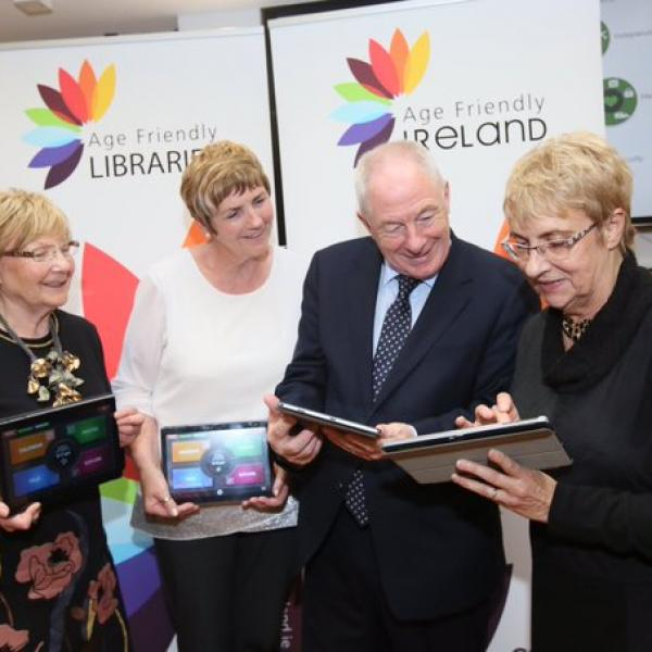 Members of Meath and Fingal's Older People's Councils showing Minister Ring the benefits of using their ACORN tablet